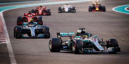 Mercedes AMG Petronas F1 Team's British driver Lewis Hamilton (front) leads during the Formula 1 Grand Prix race